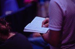 selective-focus-photo-of-person-holding-book-2351719.jpg
